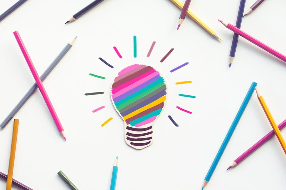 Group-of-colorful-pencil-with-light-bulb-painting-on-white